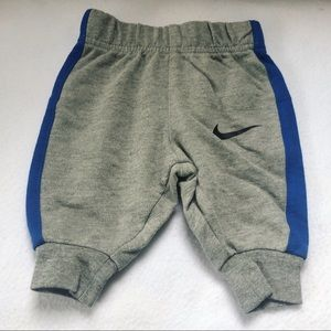 Gray Nike sweatpants with blue on the sides